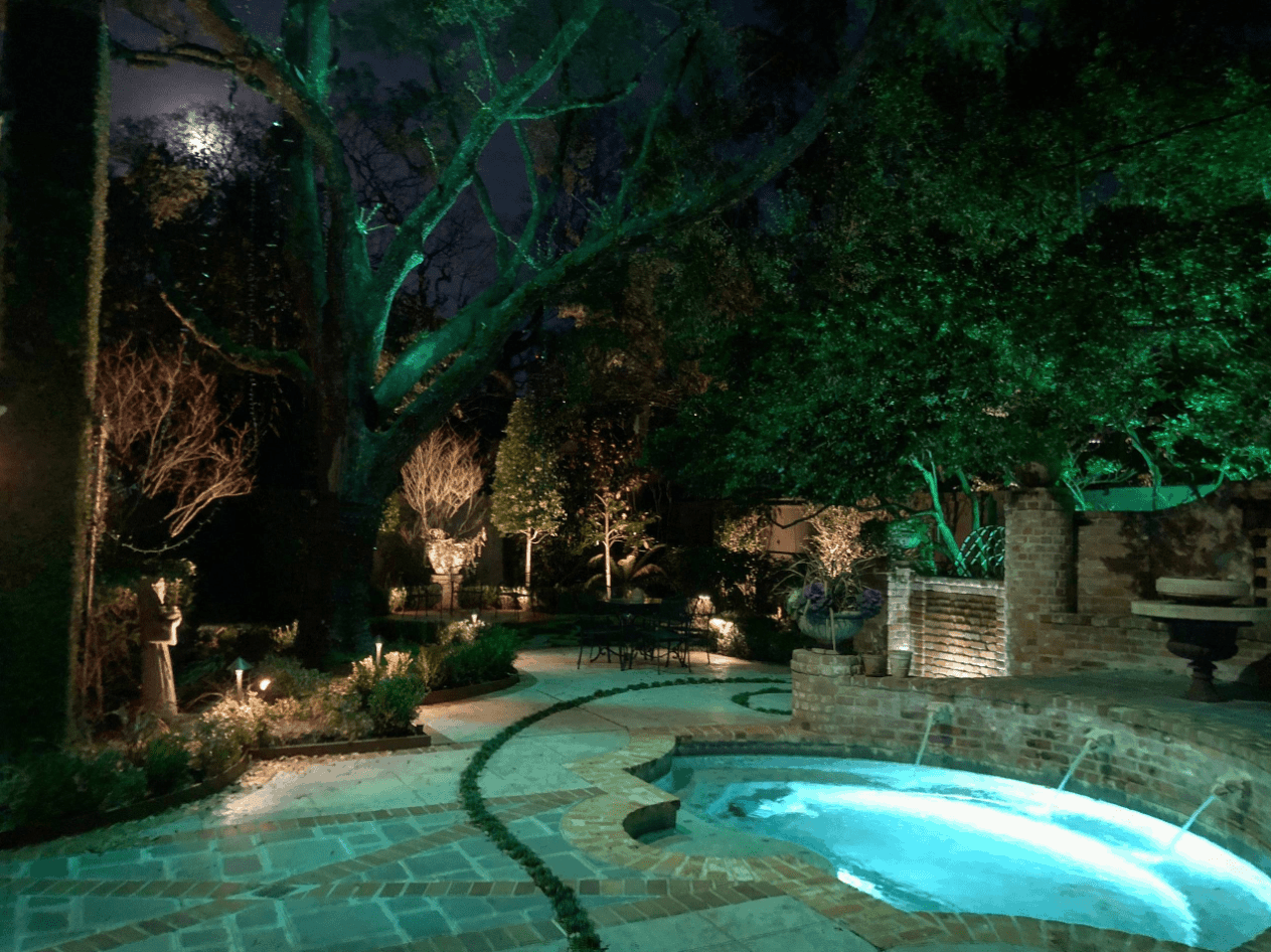 House with pool and landscape lighting