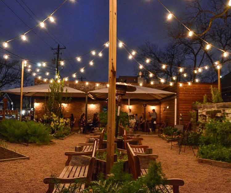 Outdoor string lights help brighten up a yard in Tanglewood Houston