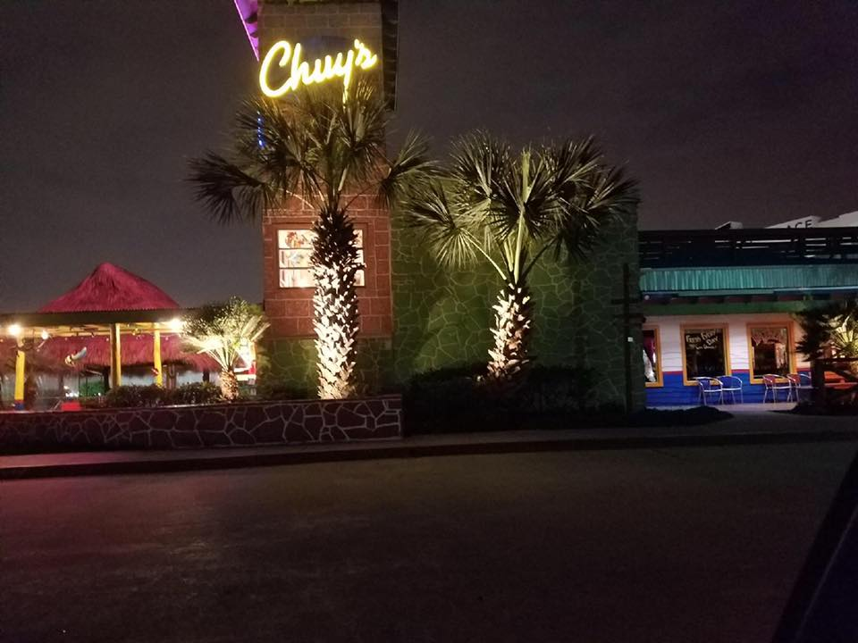 Chuy's in Montgomery Texas features a custom commercial outdoor lighting design.
