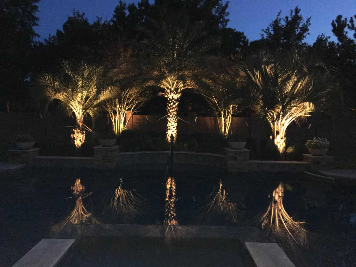 Garden lighting illuminates water feature for safe navigation of the area.