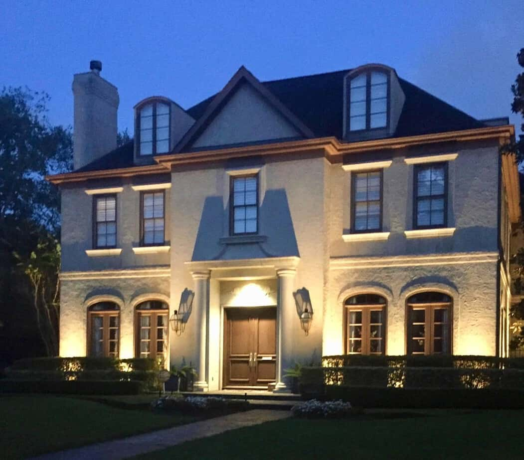 Exterior lights illuminate a beautiful home in Montgomery Texas.