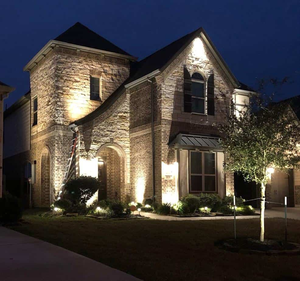 Home in River Oaks Houston features a custom landscape lighting design which adds curb appeal and safety.