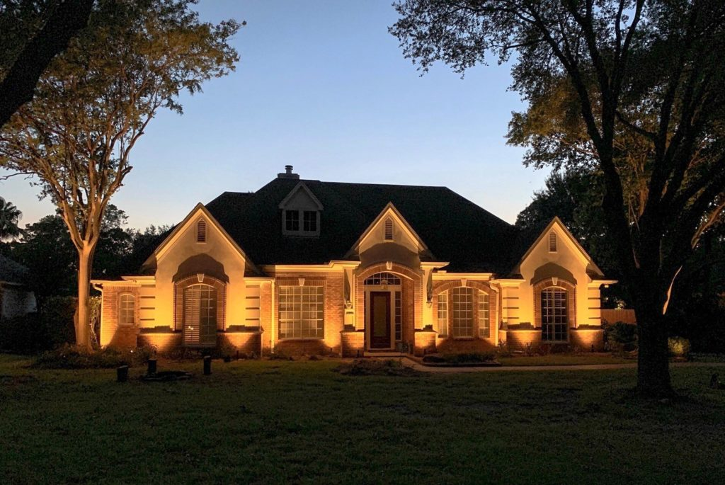 Houston residential lighting on a large house with a large door and two large windows
