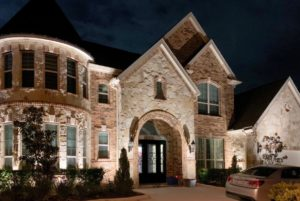 A home with landscape lighting has curb appeal from the street view