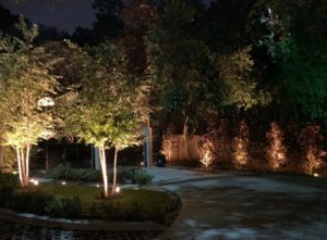 A driveway is lit up with outdoor security lights in Houston