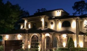 A property is secured by adding outdoor security lights to the exterior