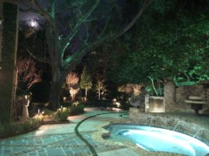 Backyard lights brighten up a backyard's patio and pool