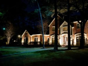 One of the popular lighting techniques, silhouetting, uses contrast to emphasize the shape of 3 trees in front of a house