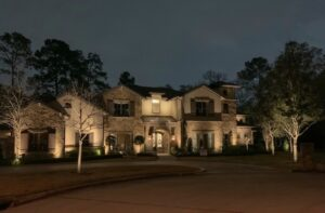 Memorial Villages Houston Tx home, the Traditional village homestead is a two story, lengthy home lit up at night.