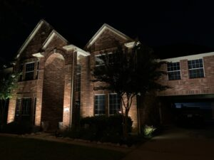 LED light maintenance was used to maintain this 2 story brick house with an archway